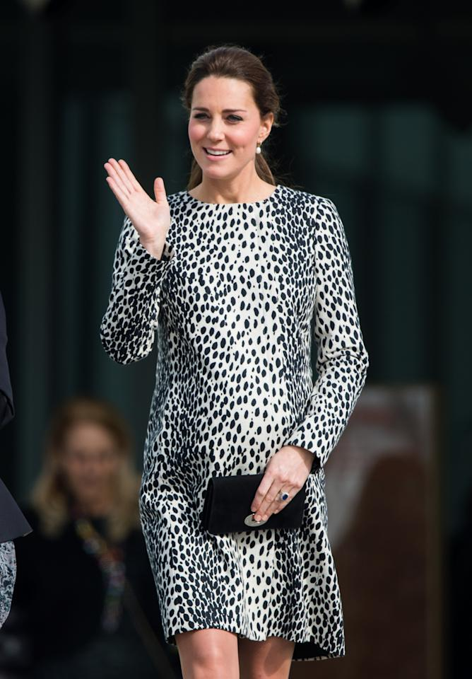 <p>The duchess is the master of hiding her baby bump. One cover-up style came in the form of a leopard-print dress by High Street brand Hobbs. (Photo: PA) </p>