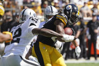 Pittsburgh Steelers running back Najee Harris (22) is tackled by Las Vegas Raiders inside linebacker Cory Littleton (42) and defensive back Johnathan Abram, rear, during the first half of an NFL football game in Pittsburgh, Sunday, Sept. 19, 2021. (AP Photo/Keith Srakocic)