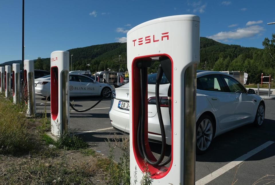 GULSVIK, NORWAY - AUGUST 09: Tesla cars charge at a Tesla Supercharger charging station on August 9, 2020 in Gulsvik, Norway. Norway has the highest percentage of electric cars per capita in the world. In March, 2020, all-electric electric car sales accounted for 55.9% of new car sales. (Photo by Sean Gallup/Getty Images,)