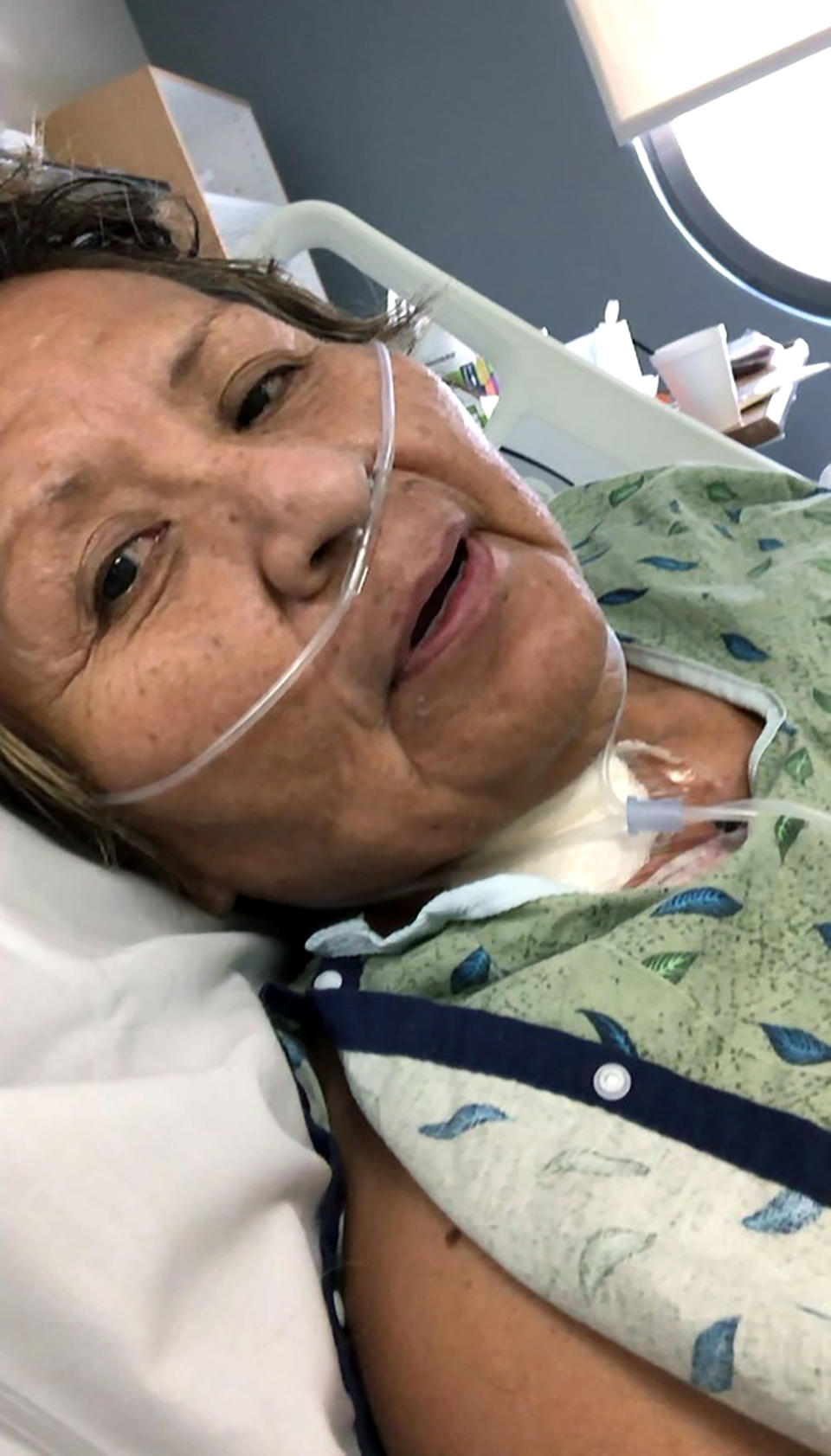 This April 17, 2020 photo provided by Shannon Todecheene shows her mother, Carol Todecheene, in a Phoenix hospital after contracting the coronavirus. Carol Todecheene was among those severely hit with the virus. (Shannon Todecheene via AP)