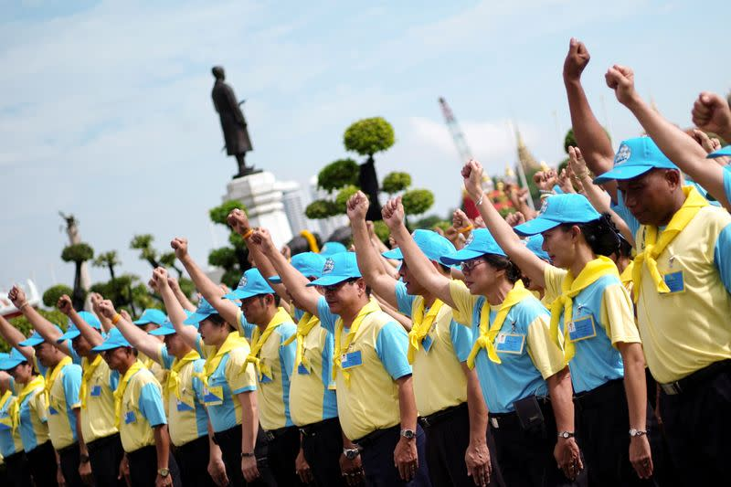 FILE PHOTO: Thai royal volunteers prepare to do painting and gardening work at the Temple of Dawn in Thonburi, Bangkok, Thailand