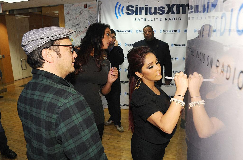 """Snooki and JWoww -- along with """"Saturday Night Live"""" alum Rob Schneider -- autographed a wall following their radio interview. We're sure it'll be worth millions some day ... (2/1/2012)"""