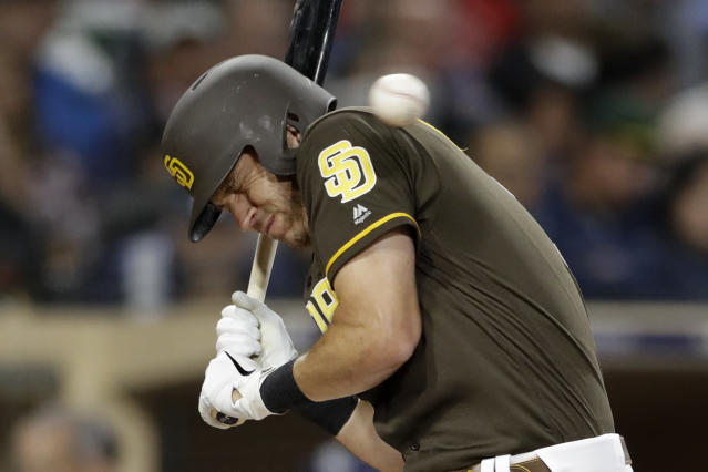 San Diego Padres' Ian Kinsler moves away from a high and inside pitch during the fifth inning of the team's baseball game against the Cincinnati Reds, Friday, April 19, 2019, in San Diego. (AP Photo/Gregory Bull)