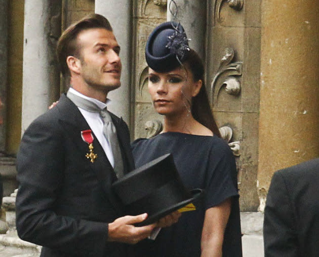Soccer star David Beckham and his wife Victoria arrive at Westminster Abbey before the wedding of Britain's Prince William and Kate Middleton, in central London April 29, 2011. (ROYAL WEDDING/VIP) REUTERS/Kai Pfaffenbach (BRITAIN - Tags: ROYALS ENTERTAINMENT SOCIETY) BEST QUALITY AVAILABLE