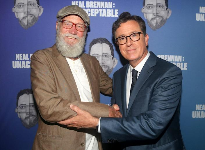 <p>David Letterman and Stephen Colbert pose at the opening night arrivals for <em>Neal Brennan's Unacceptable</em> at the Cherry Lane Theatre on Sept. 9 in N.Y.C.</p>