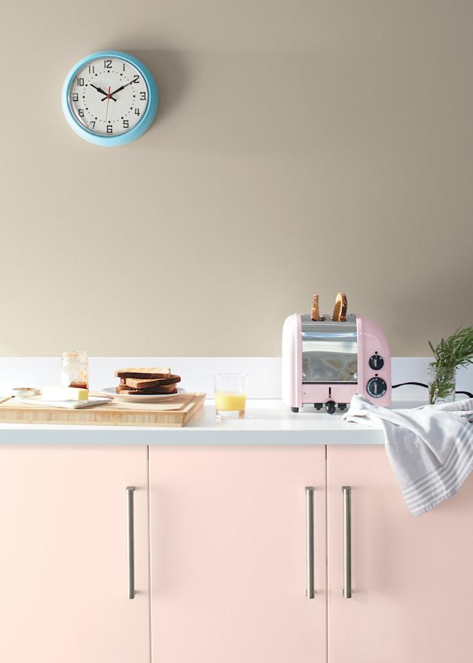 """<p>Blush may not be the first color you think of to <a href=""""https://www.realsimple.com/home-organizing/decorating/decorating-kitchen/kitchen-cabinet-trends-2019"""" target=""""_blank"""">paint your kitchen cabinets</a>, but after seeing First Light in this charming kitchen, you may just be convinced. </p>"""