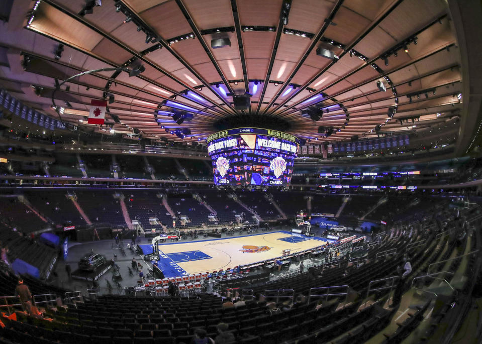 Fans arrive for an NBA basketball game between the Golden State Warriors and the New York Knicks on Tuesday, Feb. 23, 2021, in New York. A limited number of fans were allowed to attend. (Wendell Cruz/Pool Photo via AP)