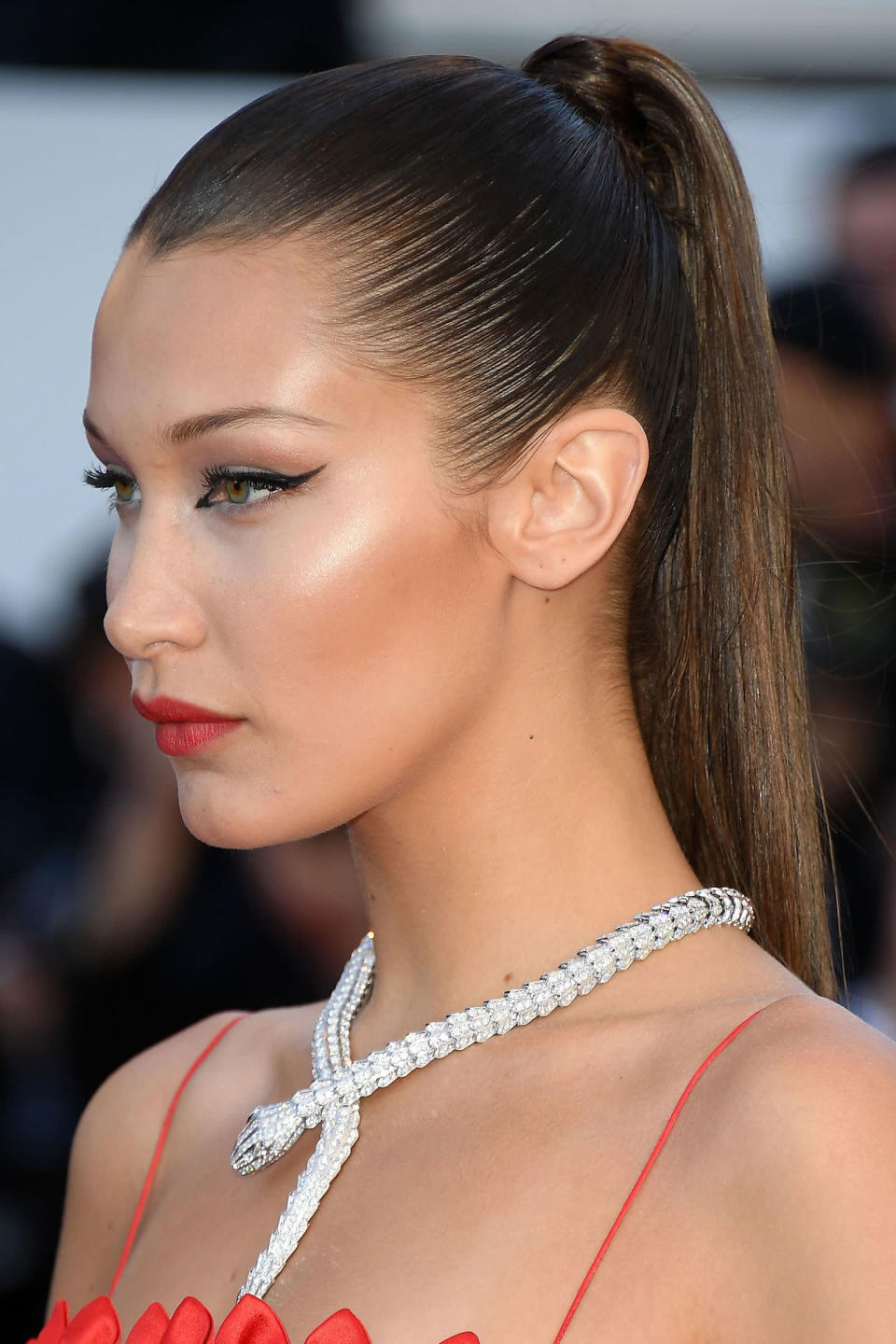 <p>The Dior beauty ambassador made a statement with her make-up, combining graphic liquid liner and cherry red lipstick.</p>