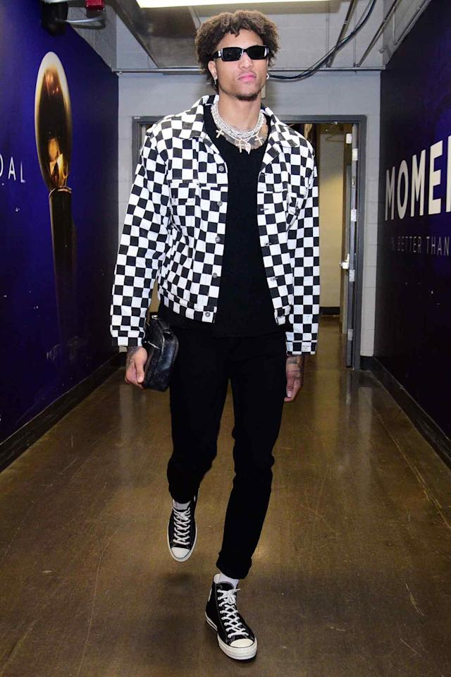 <p>WHAT: Converse sneakers</p> <p>WHERE: Arriving at a Utah Jazz vs. Phoenix Suns game in Phoenix</p> <p>WHEN: March 13, 2019</p> <p>WHY: NBA goth god Kelly Oubre Jr. is a reminder that it's <em>almost</em> time to break out all your good jackets.</p>