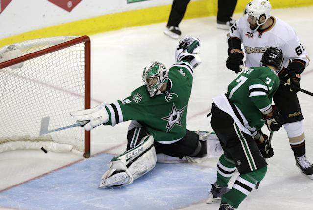 Dallas Stars goalie Kari Lehtonen (32) can't stop the goal by Anaheim Ducks Nick Bonino, not shown, as Patrick Maroon (62) and Stars Dallas Stars Patrik Nemeth (37) look on during overtime of Game 6 of a first-round NHL hockey playoff series in Dallas, Sunday, April 27, 2014. (AP Photo/LM Otero)