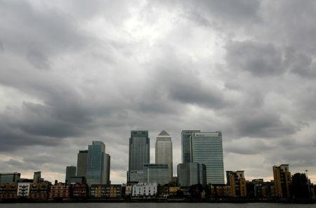 Storm clouds above Canary Wharf financial district in London