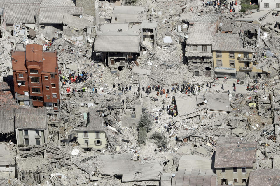FILE - In this Wednesday, Aug. 24, 2016 file photo, an aerial photo shows the damaged buildings in the town of Amatrice, central Italy, after an earthquake. The Italian town of Amatrice, hardest hit by an earthquake last month, has filed Monday, Sept. 12, 2016, a criminal complaint denouncing French satirical weekly Charlie Hebdo for a cartoon depicting victims in layers of lasagna. (AP Photo/Gregorio Borgia, File)