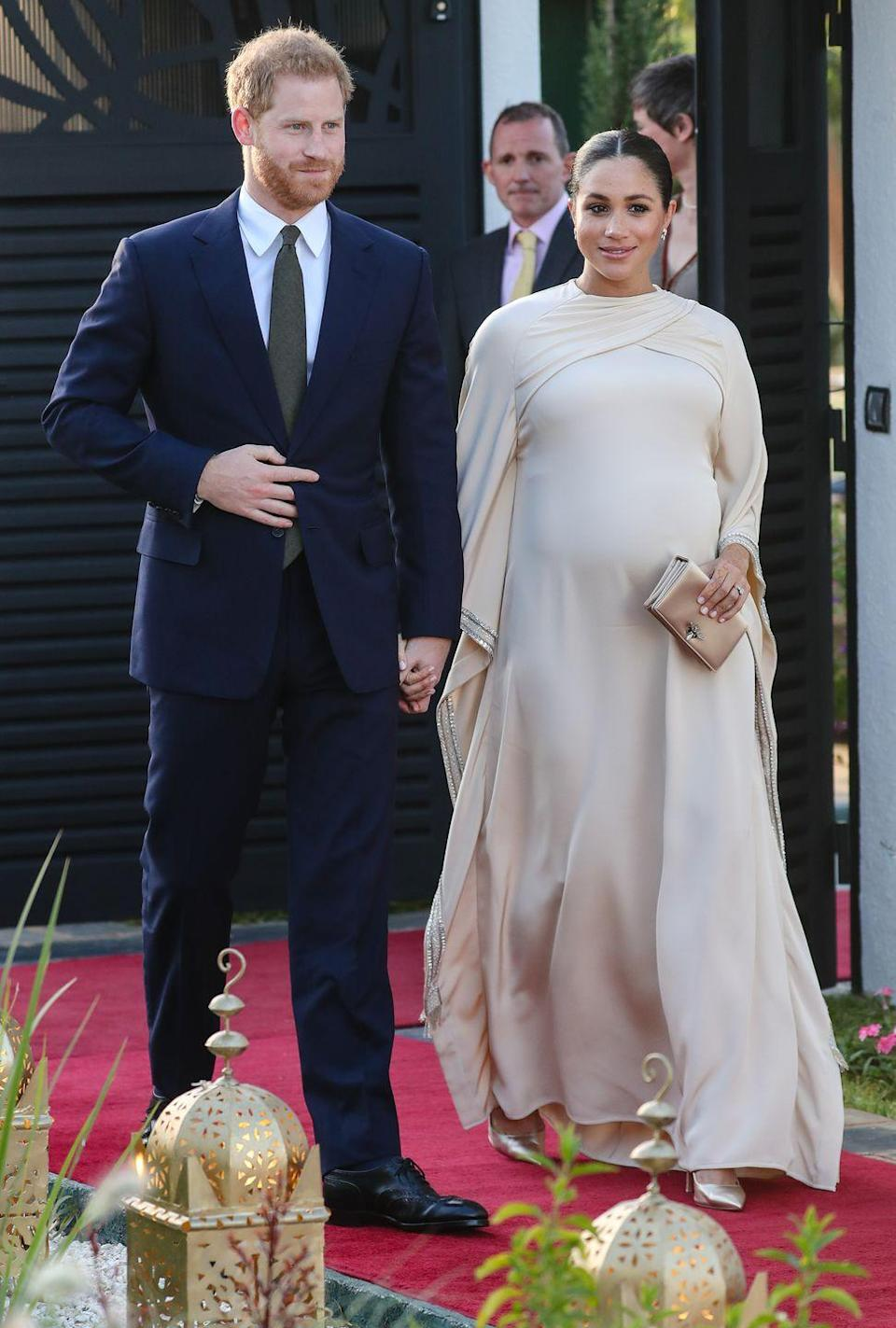 <p>While body-conscious silhouettes defined Meghan Markle's pregnancy wardrobe, there were a few exceptions — like this elegant Dior chiffon evening gown. The dramatic dress was worn during her last royal tour before giving birth to son, Archie, in 2019. </p>