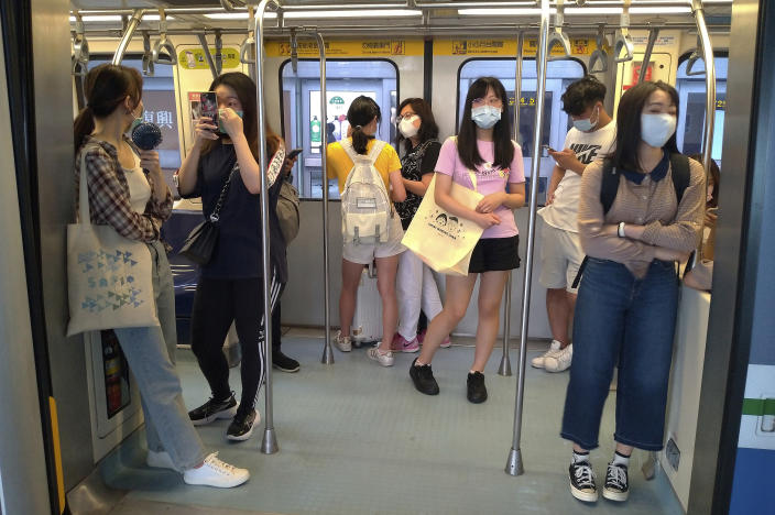 Passengers wear face masks to protect against the spread of the coronavirus at a train in Taipei, Taiwan, Saturday, June 27, 2020. (AP Photo/Chiang Ying-ying)