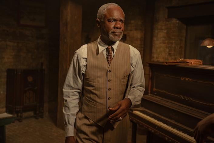 """Glynn Turman stands next to a piano in a room in """"Ma Rainey's Black Bottom."""""""