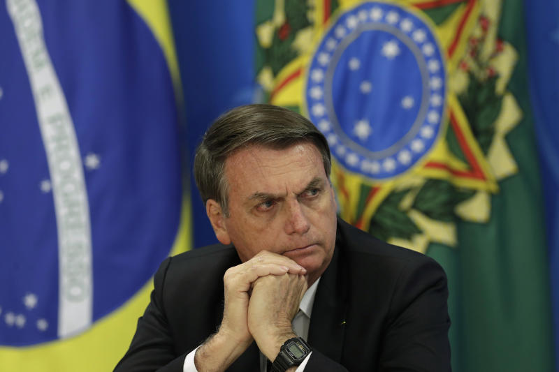 Brazil's President Jair Bolsonaro holds a press conference on deforestation in the Amazon at the Planalto presidential palace in Brasilia, Brazil, Thursday, Aug. 1, 2019. Bolsonaro is threatening to dismiss officers at the agency that monitors deforestation in the Amazon over its publication of data he disagrees with. (AP Photo/Eraldo Peres)