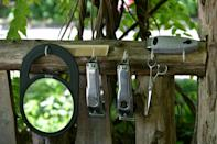 """Herman James's barber tools hang at his """"shop"""" in New York's Central Park on May 6, 2021"""