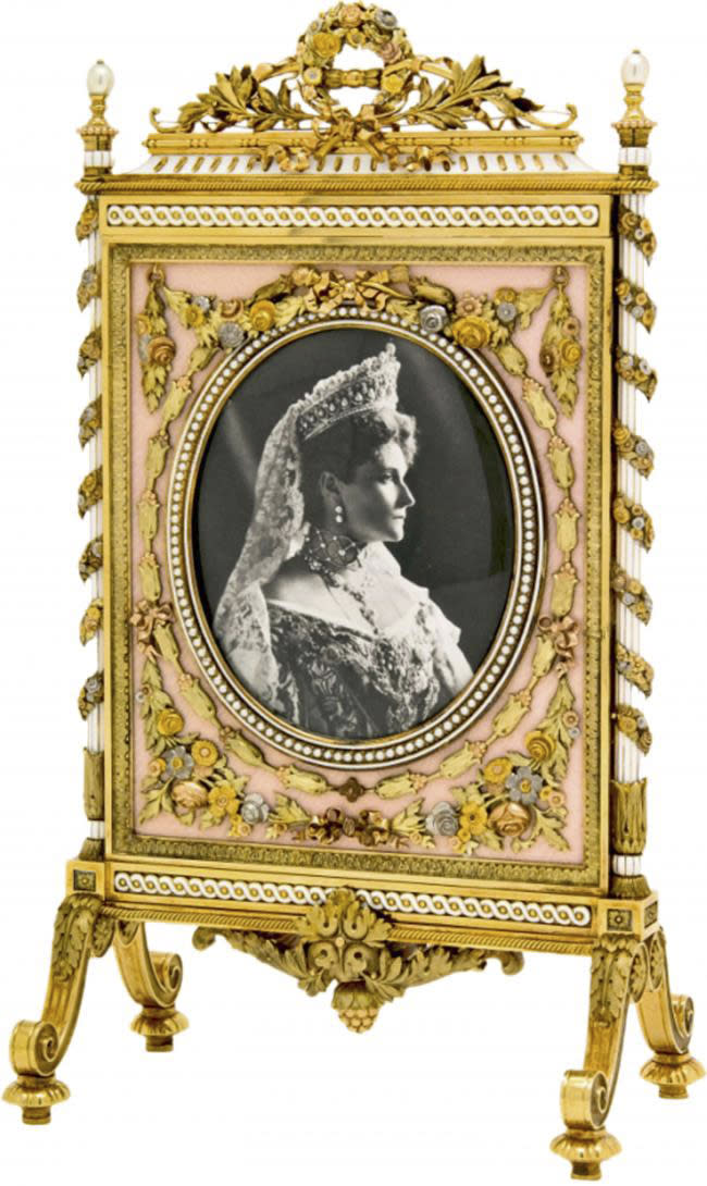 """An ornate Faberge fire screen frame, a gift from Russian Tsar Nicholas II to his mother, Dowager Empress Maria Feodorovna is shown in this undated photo from the Houston Museum of Natural Science. The screen is on display at the museum as part of the largest private collection in the United States of items from the Russian artisan Peter Carl Faberge. Featuring more than 350 objects, the exhibit """"Fabergé: A Brilliant Vision,"""" runs through Dec. 31, 2013 at the Houston Museum of Natural Science. (AP Photo/Houston Museum of Natural Science)"""