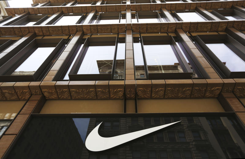 FILE - In this Thursday, June 15, 2017, file photo, the Nike logo adorns the Nike SoHo store, in the SoHo neighborhood of New York. Nike, Inc. reports earnings, Thursday, June 29, 2017. (AP Photo/Michael Noble Jr., File)