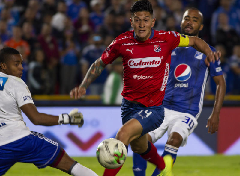 German Cano de Deportivo Independiente Medellin fights the ball against a player from Millonarios during a match between Millonarios and Deportivo Independiente Medellin as part of Liga Aguila 2019 at Estadio El Campin on March 31, 2019 in Bogota, Colombia. (Photo by Daniel Garzon Herazo/NurPhoto)