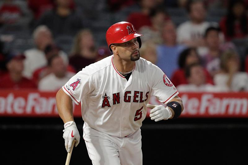 Pujols reaches 2,000 RBIs, joins Aaron and Rodriguez