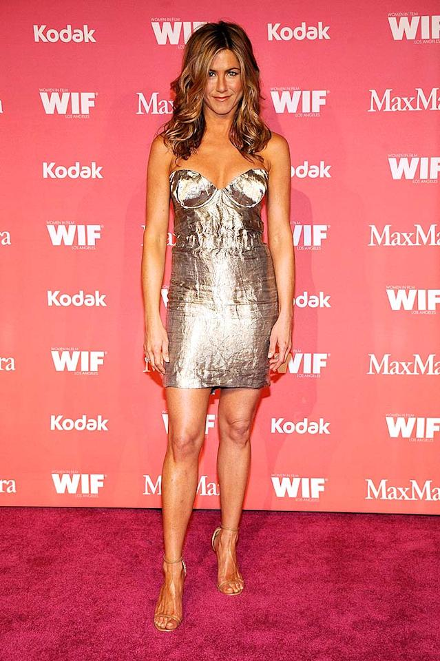 "Jennifer Aniston stole the spotlight at the 2009 Women in Film Awards when she hit the red carpet in this custom-made crushed metallic mini, courtesy of Prada. Brad Pitt, eat your heart out! Frazer Harrison/<a href=""http://www.gettyimages.com/"" target=""new"">GettyImages.com</a> - June 12, 2009"
