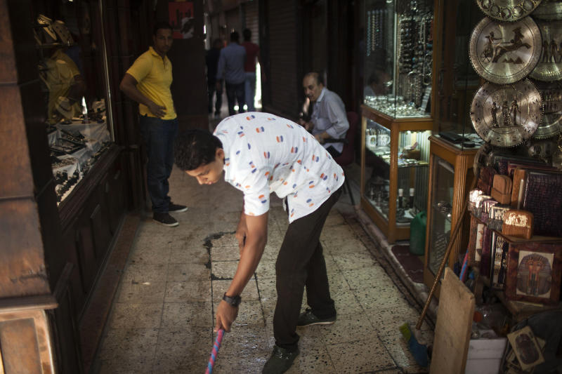 An Egyptian shopkeeper sweeps outside his souvenir shop in the Khan El-Khalili market, normally a popular tourist destination, in Cairo, Egypt, Wednesday, Aug. 21, 2013. Riots and killings that erupted across the country after the crackdown against followers of ousted President Mohammed Morsi have delivered a severe blow to Egypt's tourism industry, which until recently accounted for more than 11 percent of the country's gross domestic product and nearly 20 percent of its foreign currency revenues. (AP Photo/Manu Brabo)
