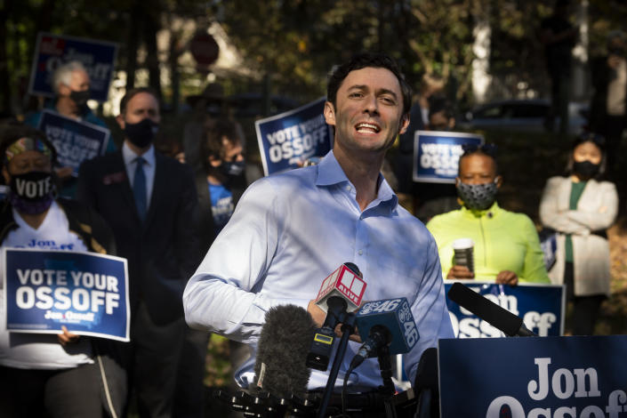 Georgia Democratic candidate for U.S. Senate Jon Ossoff speaks to the media as he rallies supporters for a run-off against Republican candidate Sen. David Perdue, as they meet in Grant Park, Friday, Nov. 6, 2020, in Atlanta. (AP Photo/John Amis)