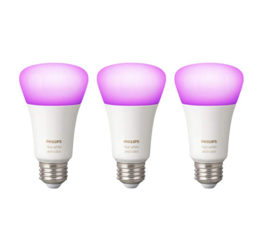 three Philips Hue A19 Smart Bluetooth LED Light Bulbs in white and pink bulbs