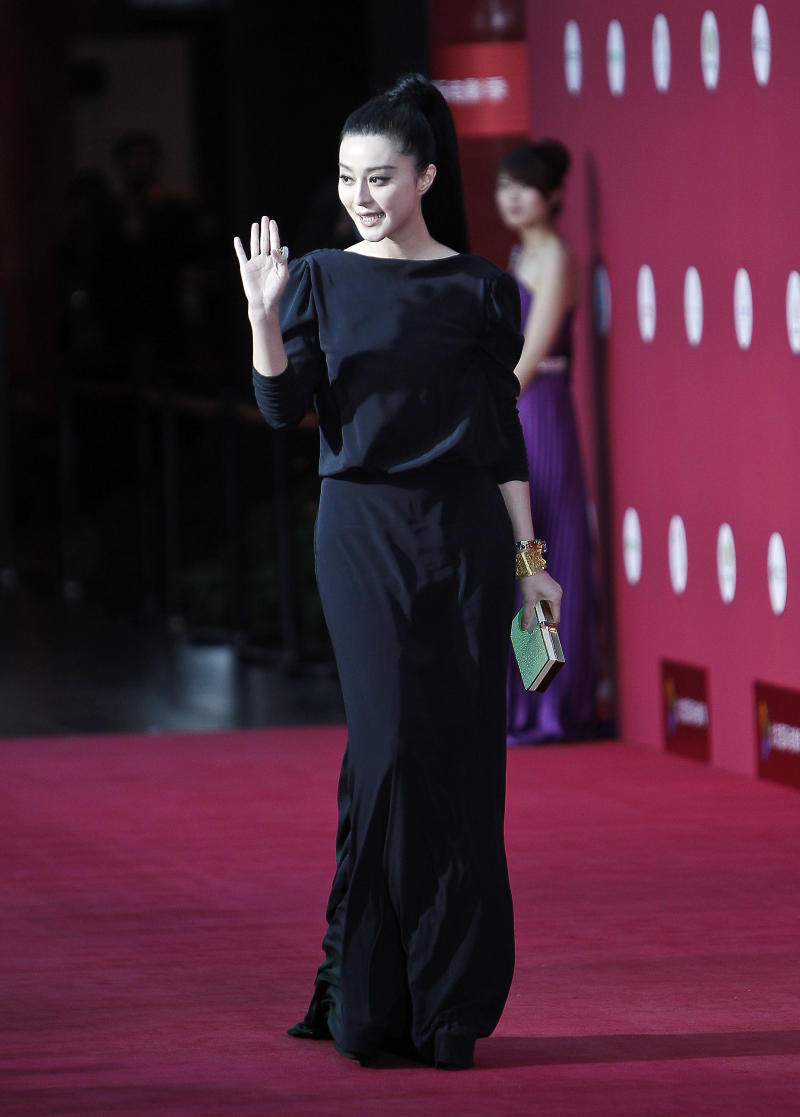Chinese actress Fan Bingbing waves to her fans as she arrives at the opening of the Beijing International Film Festival in Beijing Saturday, April 23, 2011. (AP Photo/Andy Wong)