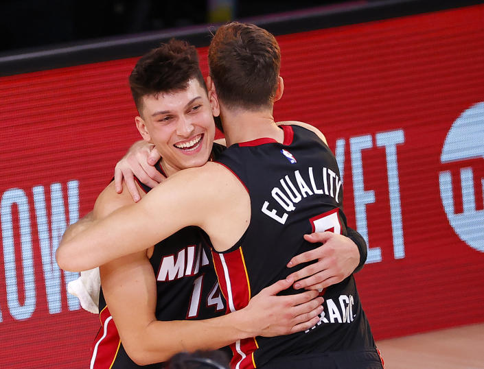 Goran Dragic embraces Miami Heat teammate Tyler Herro after the rookie's career-high 37 points in a pivotal Game 4 of the Eastern Conference finals. (Kevin C. Cox/Getty Images)