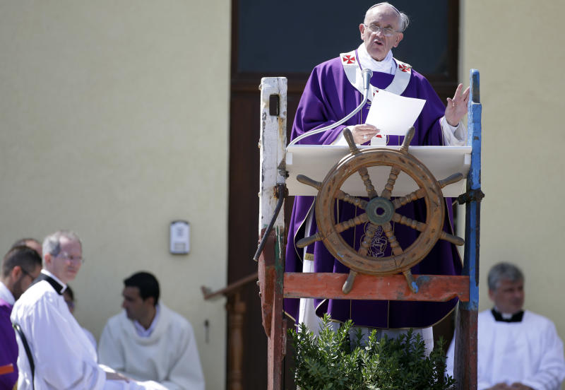 Pope Francis delivers his message as he celebrates a mass during his visit to the island of Lampedusa, southern Italy, Monday July 8, 2013. Pope Francis traveled Monday to the tiny Sicilian island of Lampedusa to pray for migrants lost at sea, going to the farthest reaches of Italy to throw a wreath of flowers into the sea and celebrate Mass as yet another boatload of Eritrean migrants came ashore. (AP Photo/Gregorio Borgia)