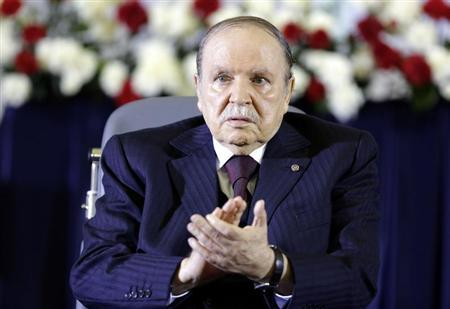 President Abdelaziz Bouteflika claps during a swearing-in ceremony in Algiers