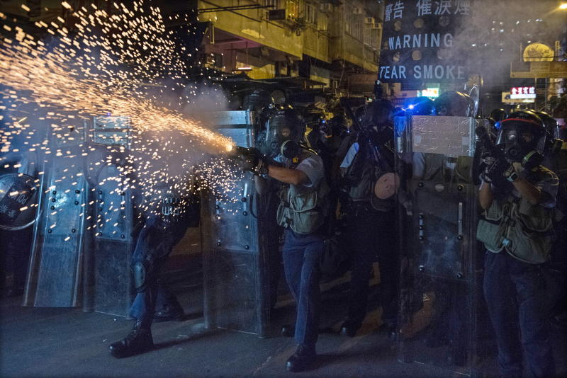 Photo shows police firing tear gas to disperse protesters attending an anti-government rally in Sham Shui Po, Hong Kong.