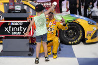Kyle Busch has water poured on him by his son, Brexton, after winning a NASCAR Xfinity Series auto race at Nashville Superspeedway Saturday, June 19, 2021, in Lebanon, Tenn. (AP Photo/Mark Humphrey)