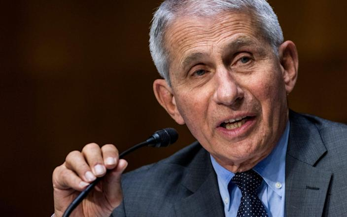Dr. Anthony Fauci, director of the National Institute of Allergy and Infectious Diseases, speaks during hearing on Capitol Hill in Washington. The United States is devoting more than $3 billion to advance development of antiviral pills for COVID-19, according to an official briefed on the matter.