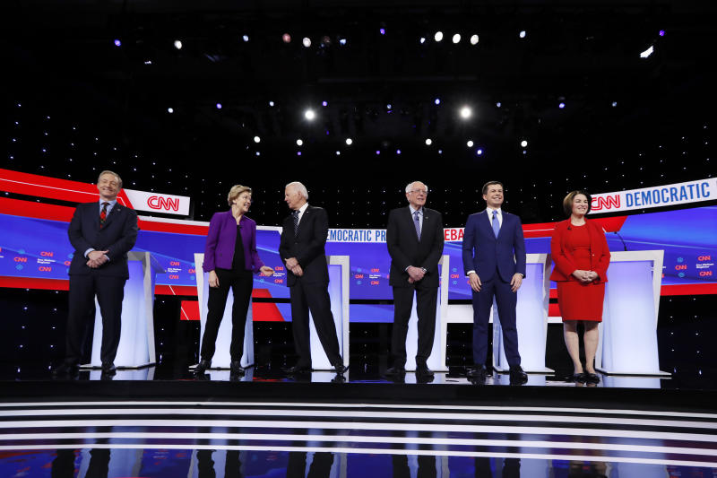 Democratic presidential candidates stand before a primary debate in Des Moines last month. (AP Photo/Charlie Neibergall)