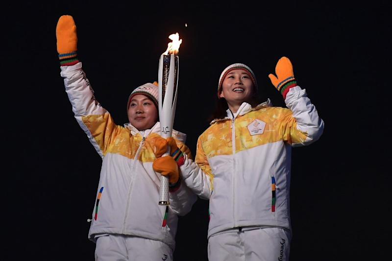 Unified Korea torchbearers during the opening ceremony of the Pyeongchang 2018 Winter Olympic Games: AFP/Getty Images