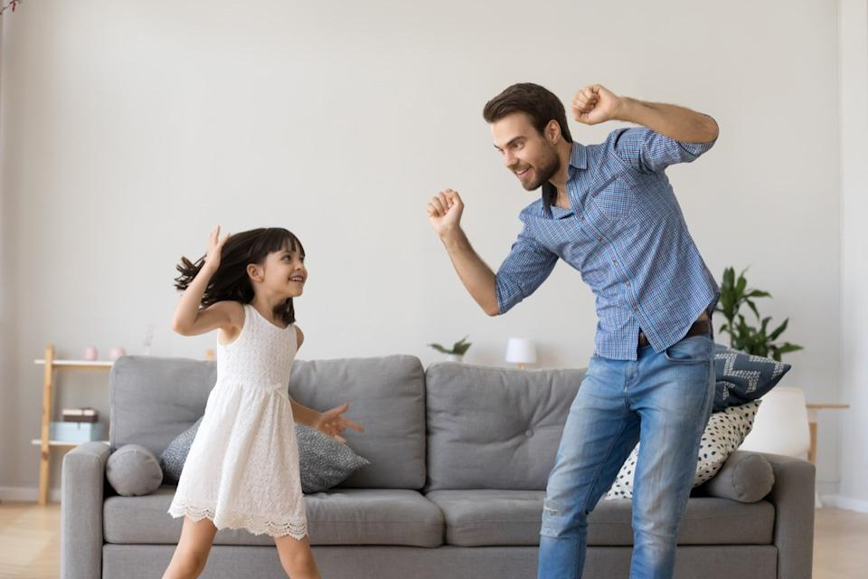 dad dancing with his daughter