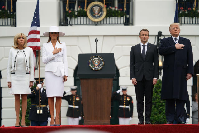 <p>President Donald Trump, French President Emmanuel Macron, first lady Melania Trump and Brigitte Macron stand during the National Anthem during a State Arrival Ceremony on the South Lawn of the White House in Washington, Tuesday, April 24, 2018. (Photo: Andrew Harnik/AP) </p>