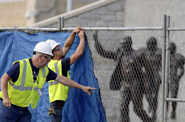 Workers removed the statue of former Penn State coach Joe Paterno on July 22, 2012. (AP Photo/John Beale)