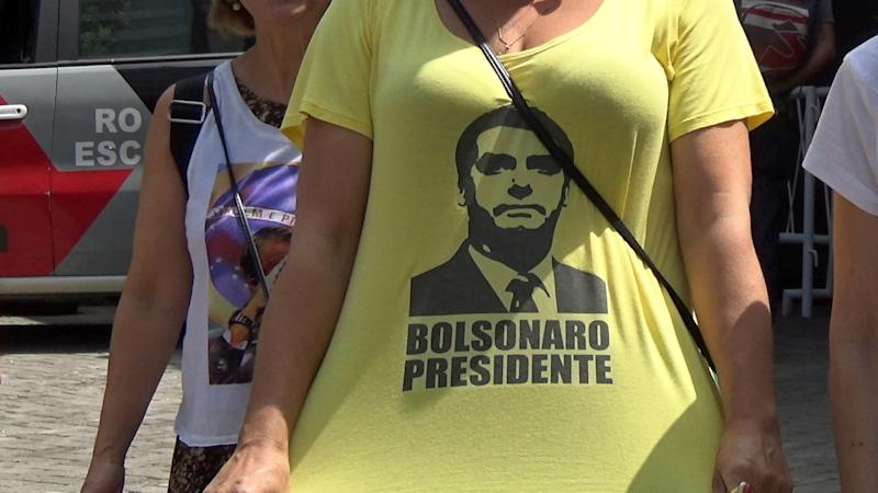 Supporters of Brazil's President Jair Bolsonaro and critics of President Jair Bolsonaro yell at each other in front of the Mackenzie University entrance on the street Consolacao and Maria Antonia in downtown Sao Paulo, Brazil on Mar. 27, 2019. Bolsonaro;s appearance at the University was cancelled. (Photo by Cris Faga/NurPhoto via Getty Images)