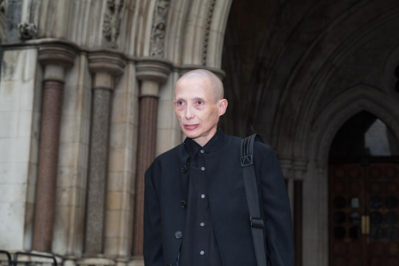 "LONDON,UNITED KINGDOM - October 11: Non-gendered campaigner Christie Elan-Cane arrives at the High Court where she is launching a fight for the right to have ""X"" passports on October 11, 2017 in London, England. Applicants currently have no choice other than to indicate whether they are male or female. PHOTOGRAPH BY Paul Davey / Barcroft Images (Photo credit should read Paul Davey / Barcroft Media via Getty Images)"