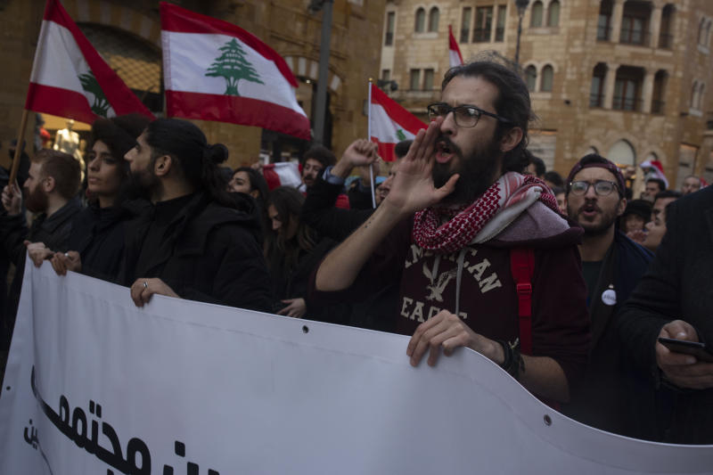 Lebanese expatriates chant anti-government slogans at a protest outside of the Parliament building Thursday, Dec. 26, 2019 in Beirut, Lebanon. (AP Photo/Maya Alleruzzo)