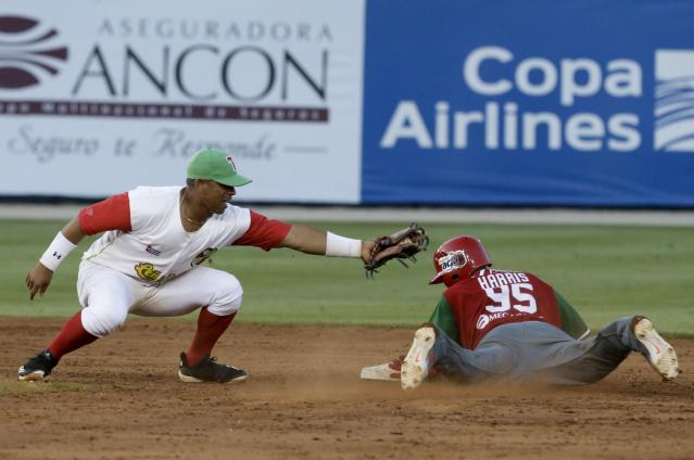 Alonzo Harris of Mexico's Los Charros de Jaliscos, slides safely to second base ahead of a tag by Jorge Aloma of Cuba's Los Leneros de las Tunas, in an extra inning of their Caribbean Series baseball tournament match at Rod Carew stadium in Panama City, Thursday, Feb. 7, 2019. (AP Photo/Arnulfo Franco)