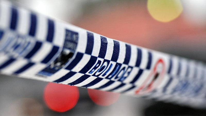 Two men have been arrested in early morning counter-terrorism raids in western Sydney.