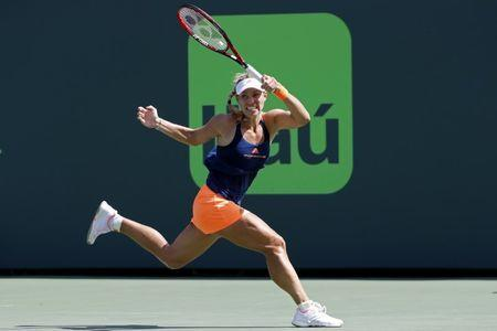 Mar 26, 2017; Miami, FL, USA; Angelique Kerber of Germany hits a forehand against Shelby Rogers of the United States (not pictured) on day six of the 2017 Miami Open at Crandon Park Tennis Center. Kerber won 6-4, 7-5. Mandatory Credit: Geoff Burke-USA TODAY Sports