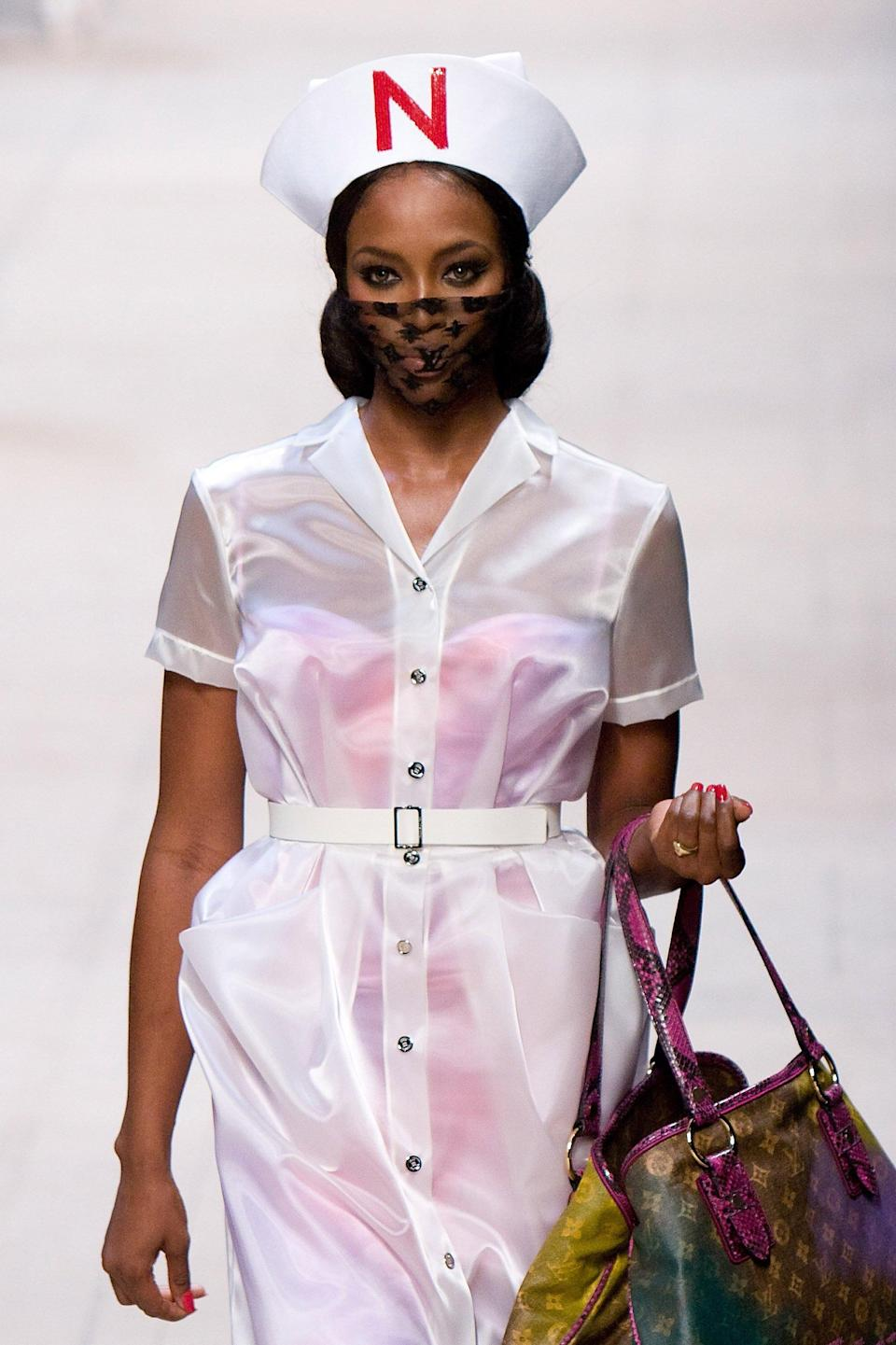 <p>20 years into her career, Naomi Campbell commanded the runway in a monogram face mask. </p>