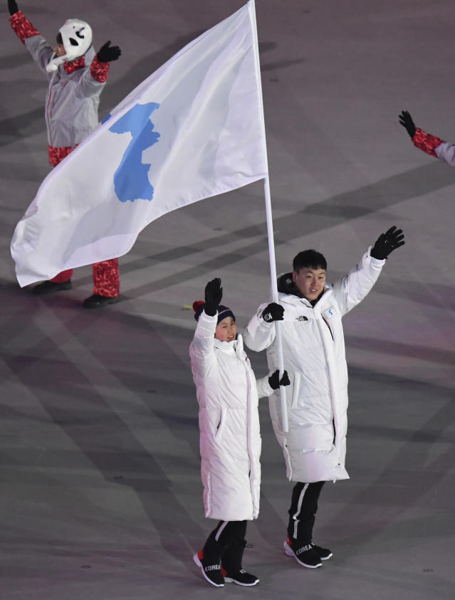 <p>North Korea's Hwang Chung Gum and South Korea's Won Yun-jong arrive during the opening ceremony of the 2018 Winter Olympics in Pyeongchang, South Korea, Friday, Feb. 9, 2018. (Franck Fife/Pool Photo via AP) </p>