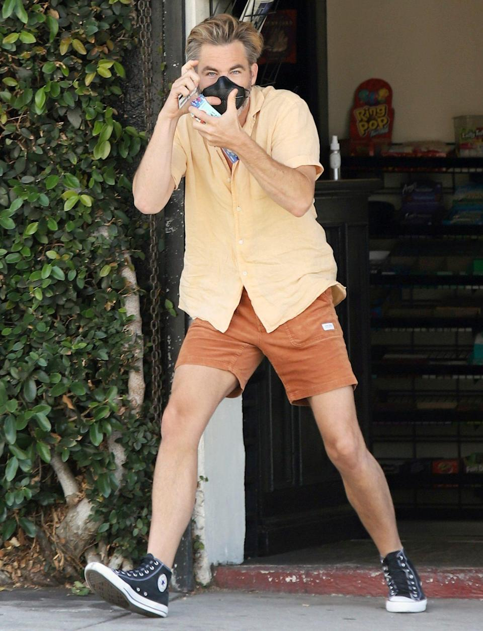 <p>Chris Pine takes a trip to the grocery store in L.A. on Sunday, pausing to pretend to take a photo of the paparazzi. </p>